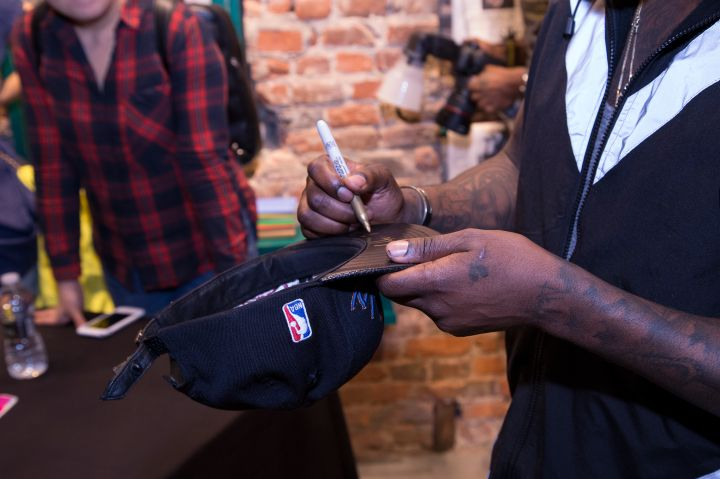 Wale Signs Copies Of His New Album 'Shine'