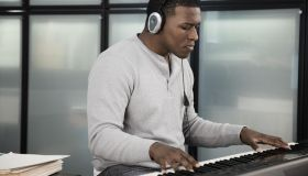Black man playing electronic keyboard
