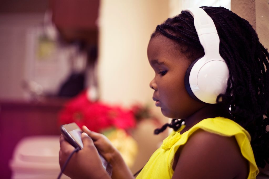 Little Girl Wearing Headphones