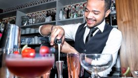 africClose-Up Of Bartender Making Drink On Counter In Baran american making cocktail