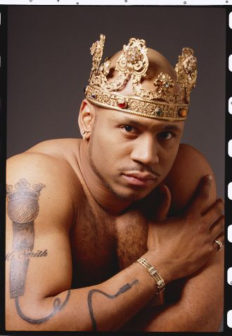 Rapper LL Cool J Barechested Wearing a Crown