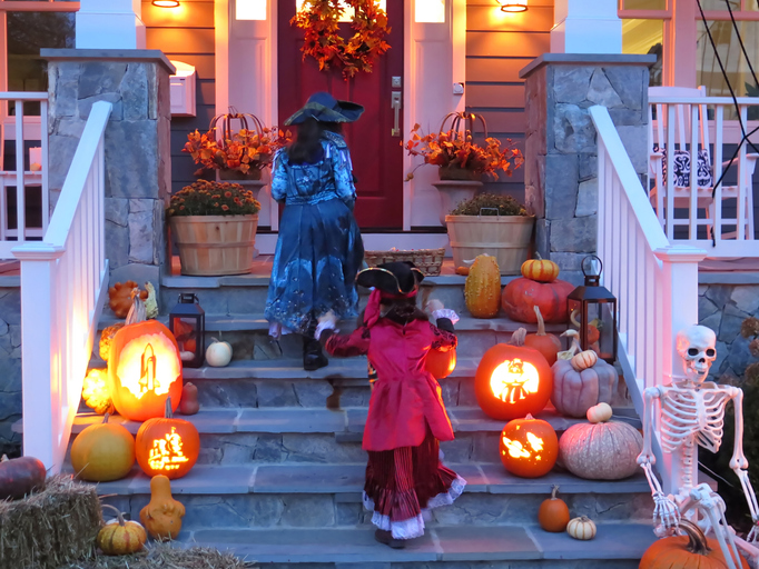 Two sisters in Pirate Costumes on Halloween trick or treating.